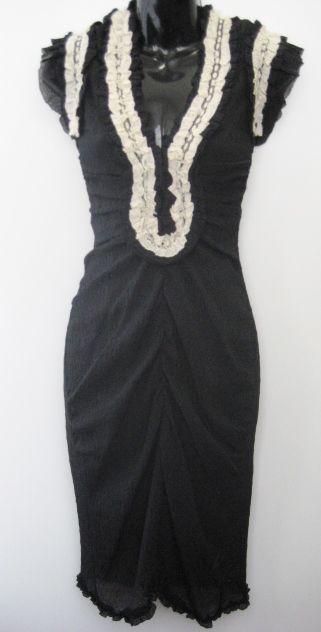 Cream dress with black lace trim