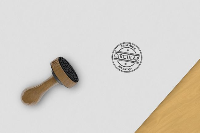 realistic circular rubber stamp on desk logo template