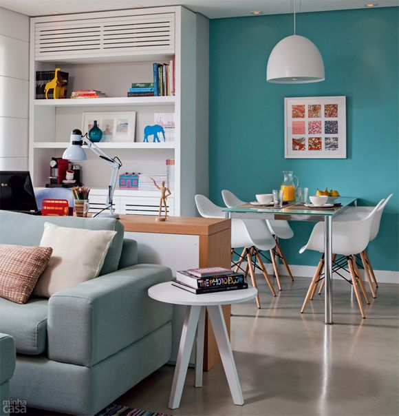 i love the blue wall in the living room. i think i would put the paint on the wall with the windows :)