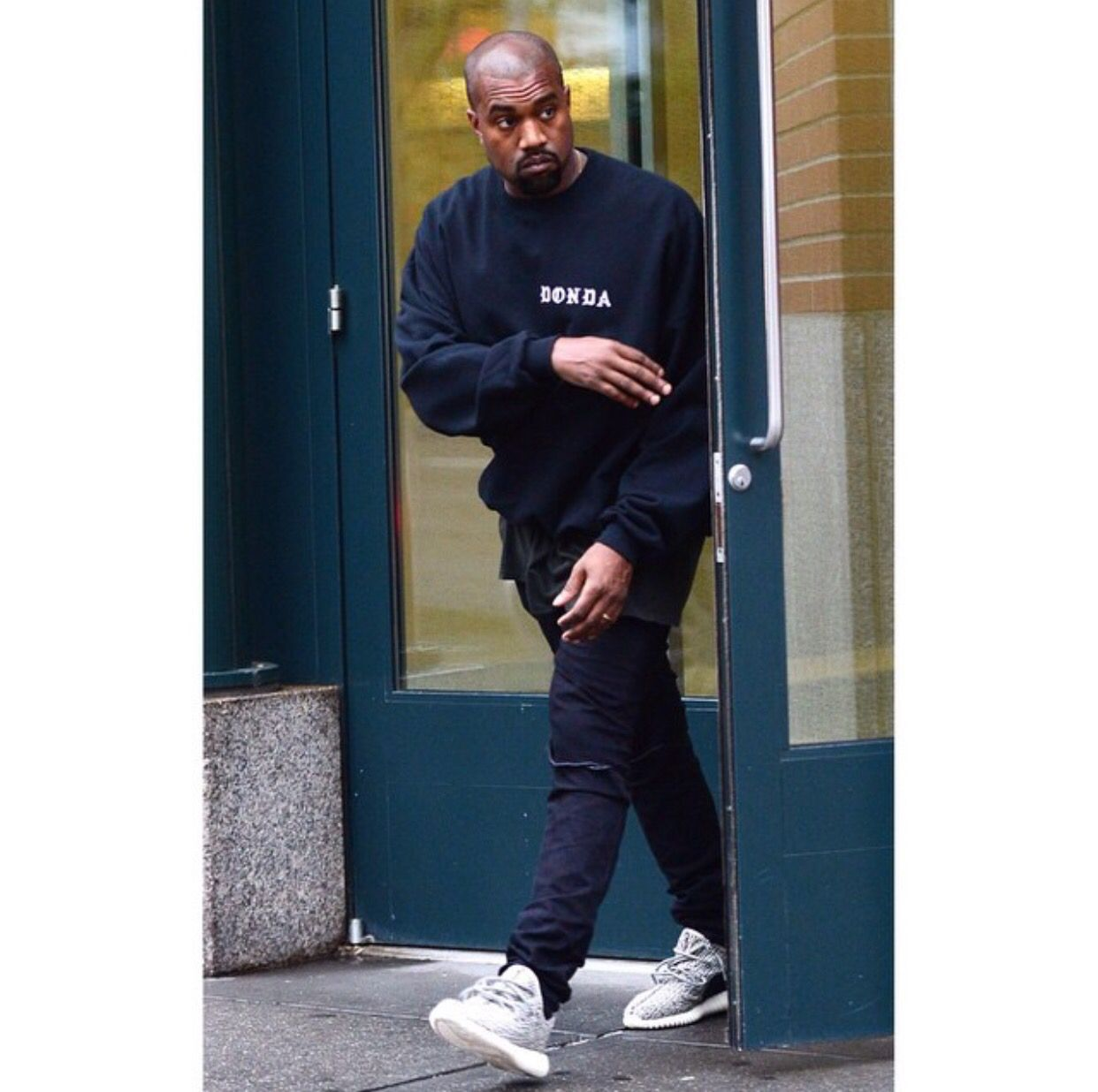 Kanye Wearing The Yeezy Boost 350 And His Donda Sweater Kanye West Outfits Kanye West Style Kanye West