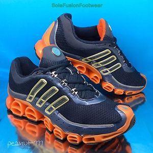 Adidas A3 hombre  Megaride corriendo Trainers SZ Azul / naranja rebote