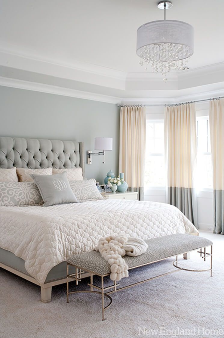 Luxe feminine decor and furniture heighten this soft grey bedroom