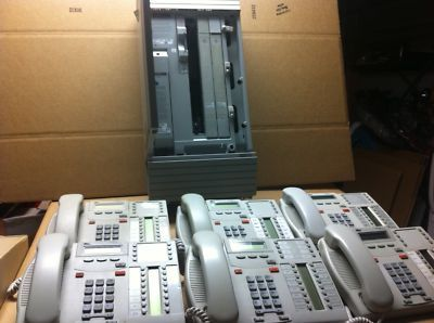 #Nortel #Norstar MICS complete system (Modular Integrated Communications System).  Just removed from service and is in perfect working condition.100% Digital.  This Model # NT7B53 Modular Integrated Communications System will currently hold 8 phone lines and 32 phone sets...System is highly expandable.  Items included in this sale:  One(1) Nortel 0X32 KSU with Rls 6.0 software  Two(2) Nortel LS/DS Analog Trunk Card  Six (6) Nortel T7316 Telephones (Platinum)  Power Cord  Hanging bracket…
