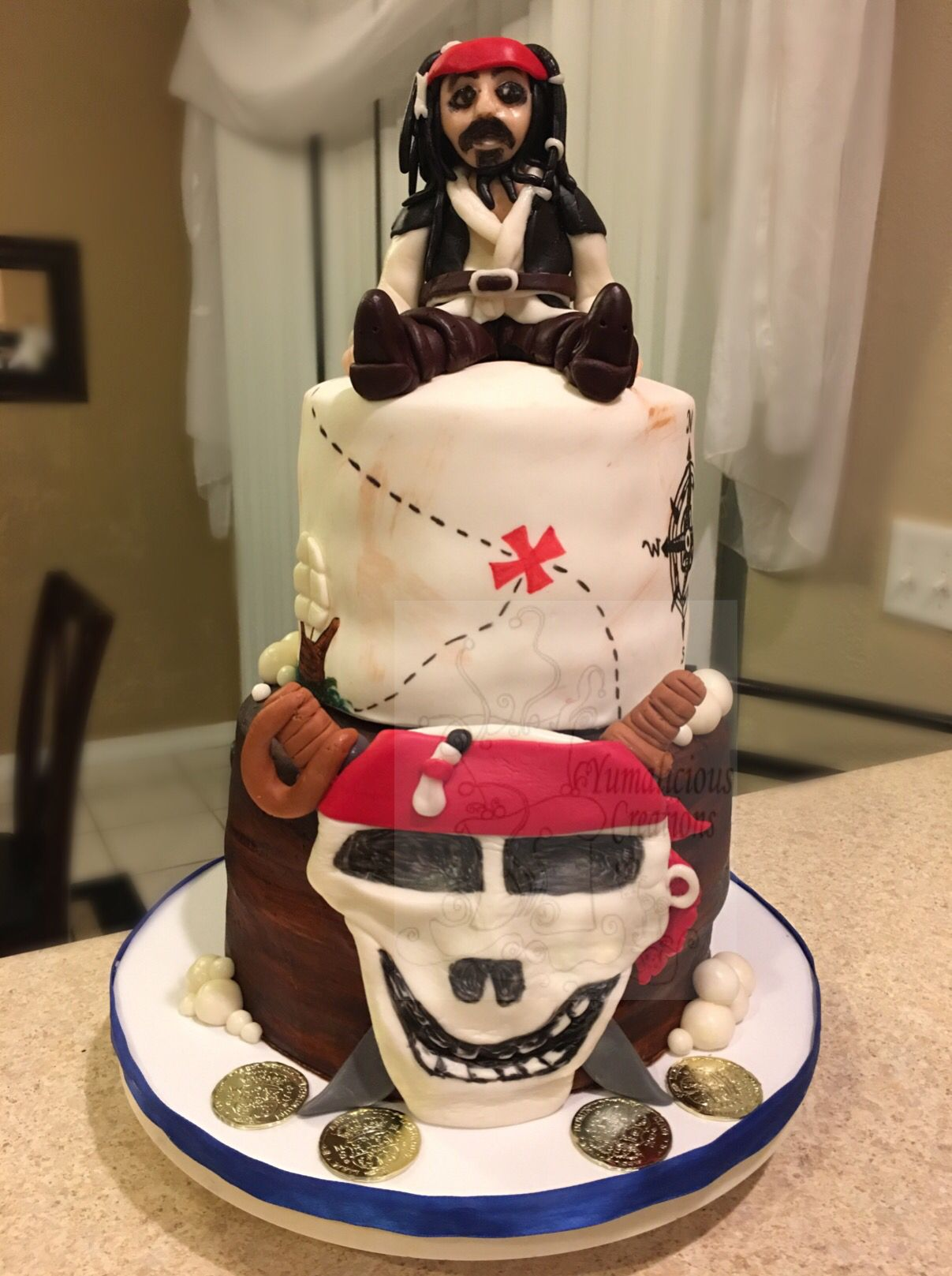 Pirates Of The Caribbean Cake With Chocolate Jack Sparrow Up Top