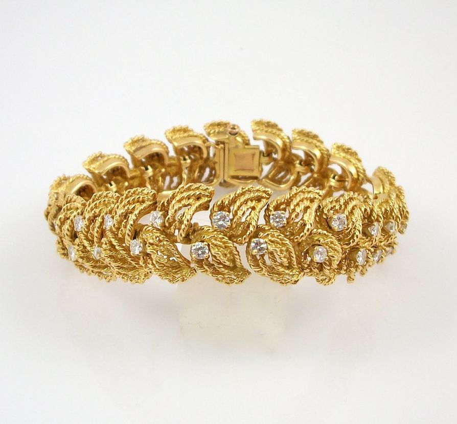 We just purchased this vintage 18kt yellow gold bracelet with over 3ct total weight of white and clean diamonds.