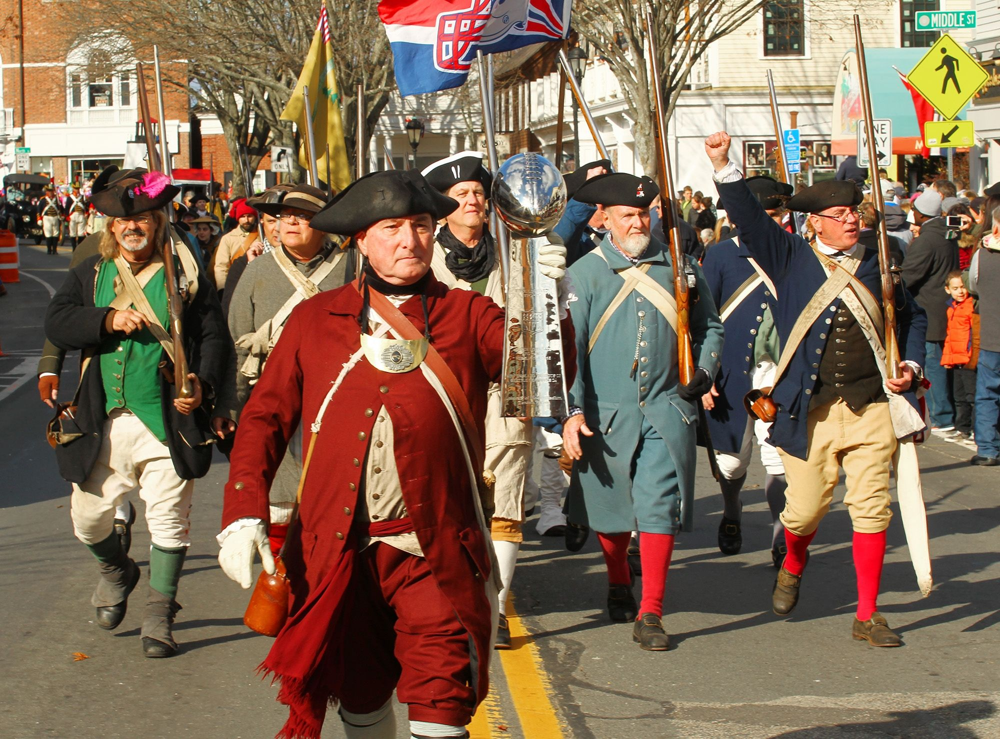 Geoffrey Campbell Of The New England Patriots End Zone Militia Marches With A Replica Vince Lombardi Thanksgiving Parade Lombardi Trophy New England Patriots