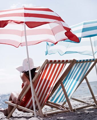 MYSINGÖ foldable beach chairs with striped fabric and umbrellas