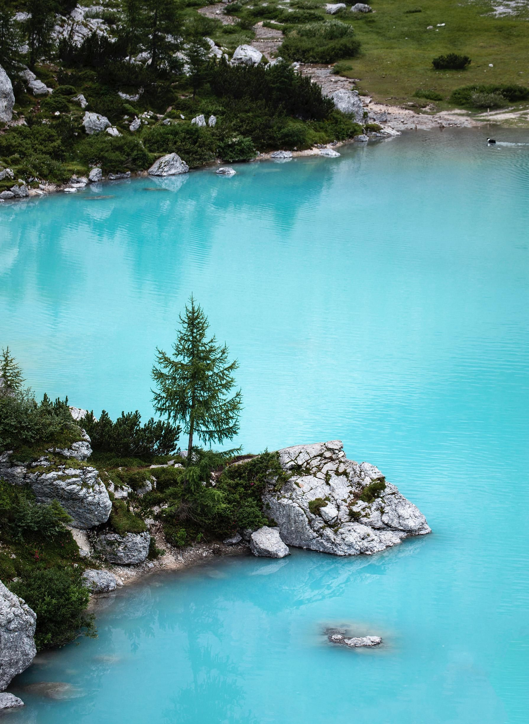 The bright blue water of Lago di The bright blue water of