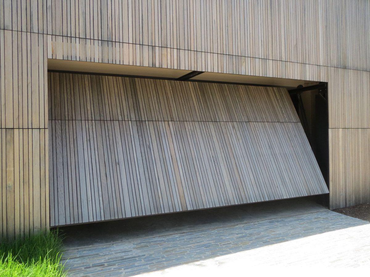 Smartech's Tilt Garage Door system opens as a single panel