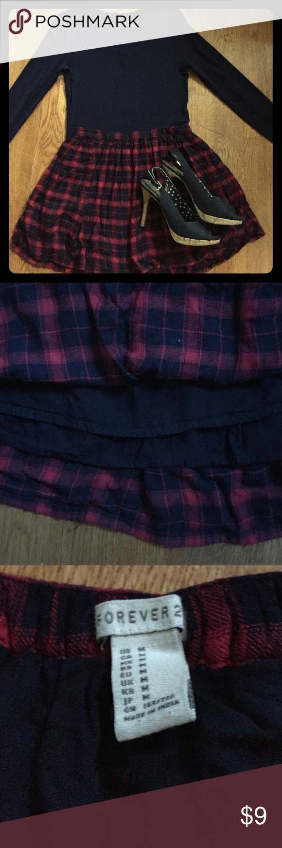 Red and Navy Plaid Skirt This skirt is adorable and comfortable. It has two layers of fabric and a partially elastic waistband. It's in great condition with no flaws. It's marked M, but I'm a S and it fits me, too. Heels also available in my closet. Comment with any questions. Forever 21 Skirts Mini