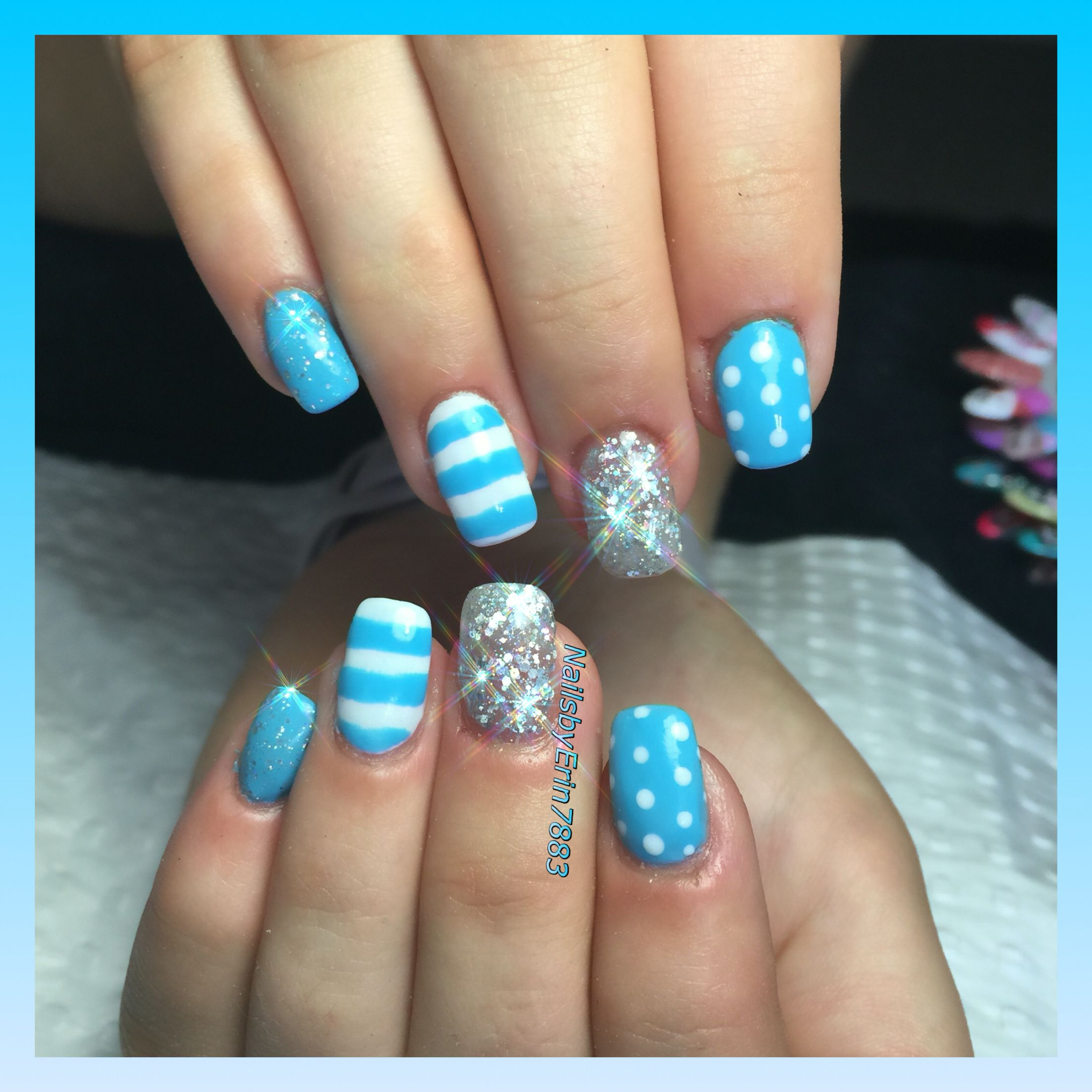 Baby Blue Acrylic Nails With Silver Bling Stripes And Lines