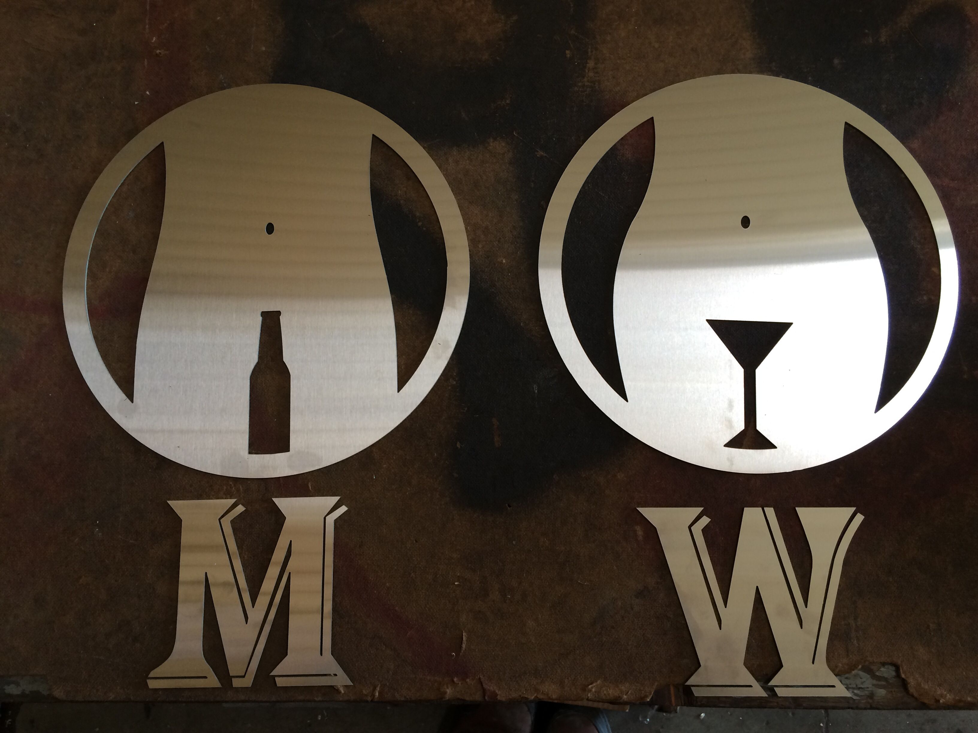 Men S And Woman Restroom Signs Waterjet Cut At Feni Technologies From 20 Gage Stainless Steel