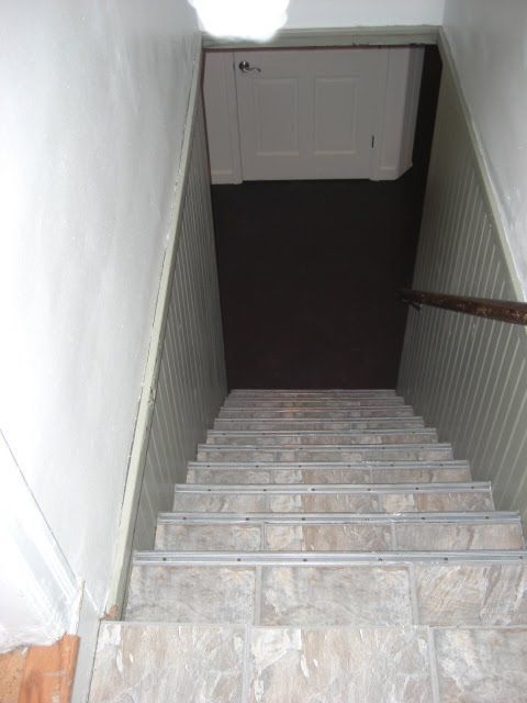 basement stairs looking down. Peel and stick vinyl tiles for a quick fix on the cellar stairs