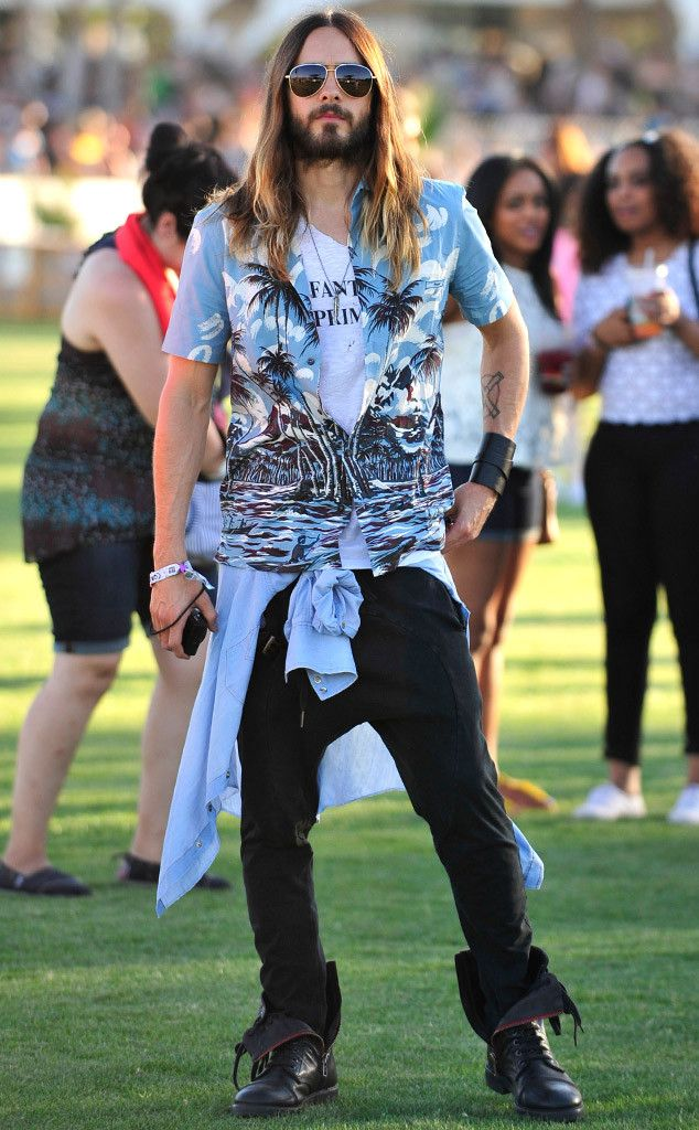 The 30 Seconds to Mars rocker, clad in a festive Hawaiian shirt, mingles in the crowd.