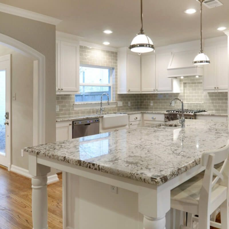white kitchen with grey granite Current Obsessions: 8 Heavenly Kitchens with White Granite