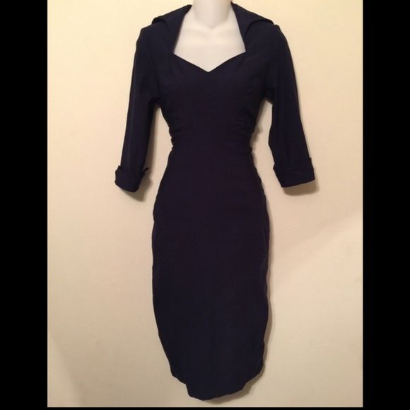 Navy pinup style midi dress Navy pinup style midi dress. Form fitting and flattering! Zipper in back. Pleated detail at hem in the back. 3/4 sleeve cuffed. Big collar. 42 inches long. Dry clean. Rayon nylon 4% spandex. Tag reads medium. Pinup Couture Dresses Midi