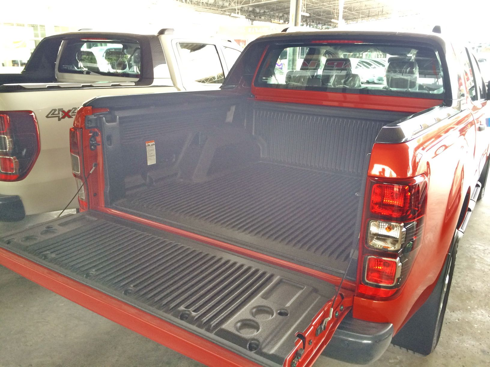 Ford ranger wildtrak 2014 model thailand orange rear view of back bed with bedliner installed at