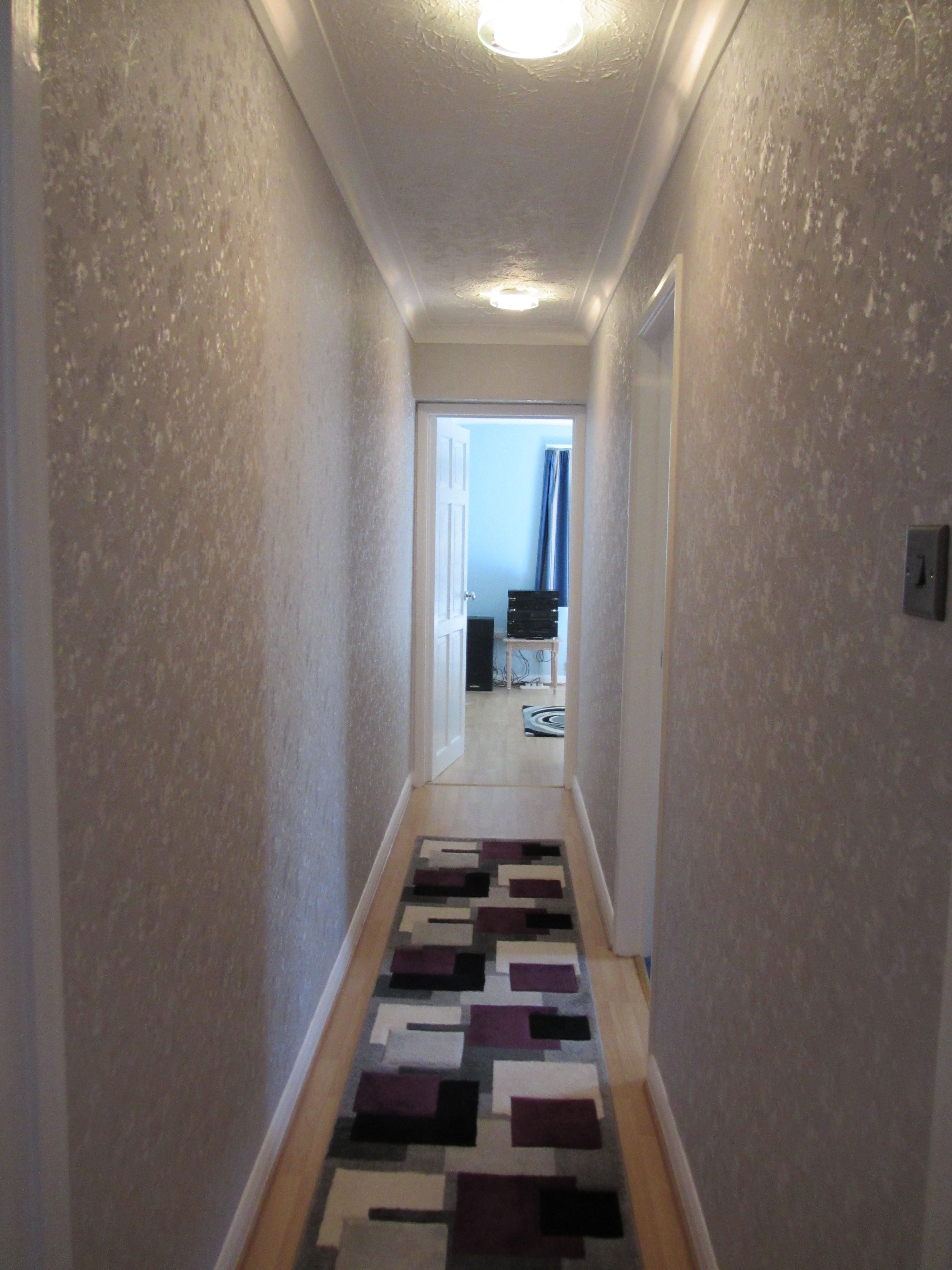 Silver wallpaper hallway  The inner hallway now finished Much brighter with a shinny silver