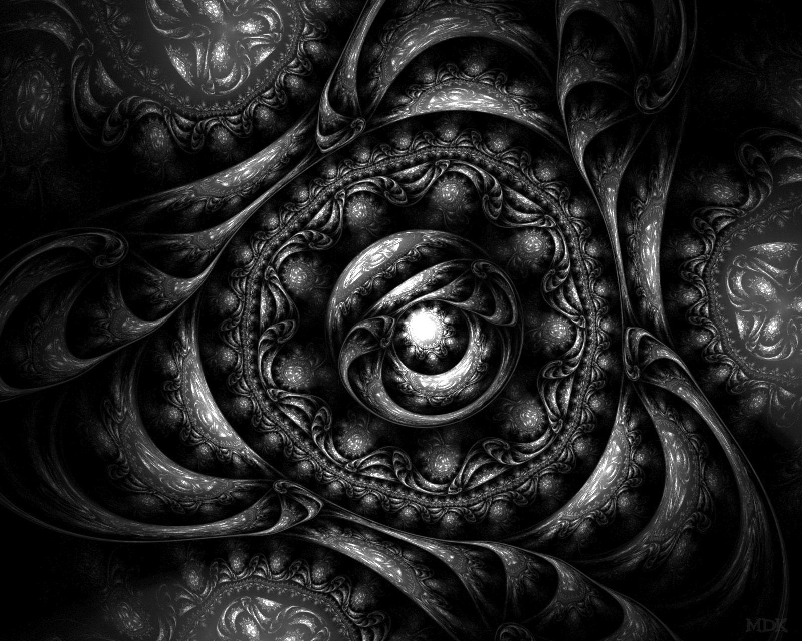 Black and white fractal  http://www.smashingmagazine.com/2009/04/26/black-and-white-fractals-that-capture-creativity/