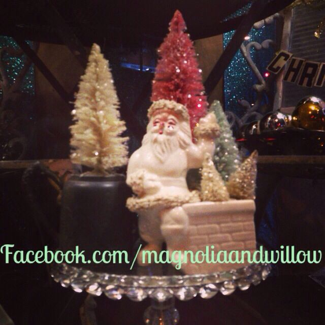 Vintage bottle brush christmas trees in a great old santa pot