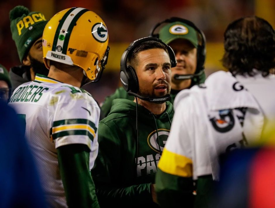 The Head Coach Of The Green Bay Packers Matt Lafleur Confers With Aaron Rodgers And Others During A Recent Away Game I Packers Green Bay Packers Packers Baby
