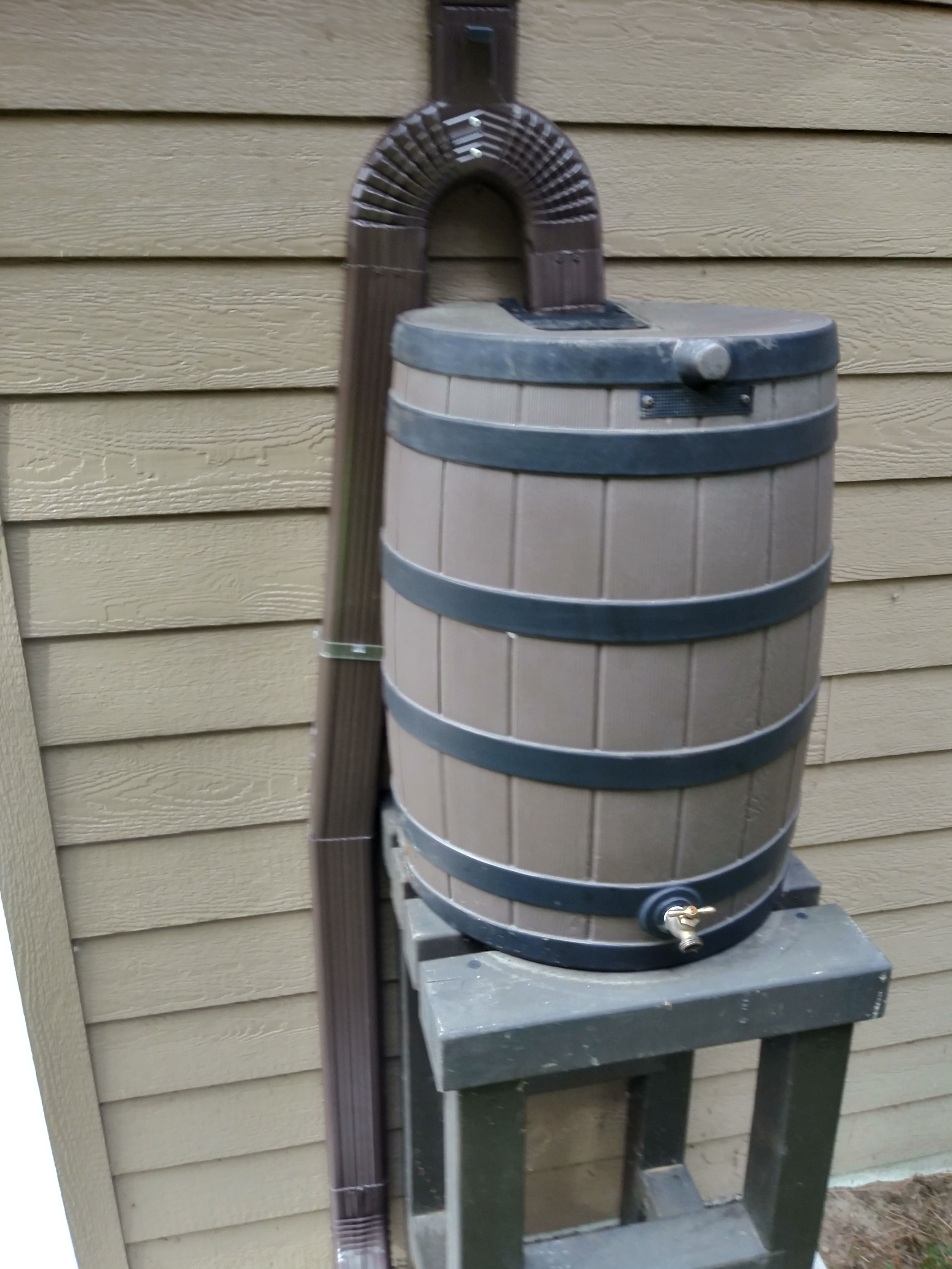 Our Technicans Installed A Leafguard Y Adapter To Connect The Downspout And Rain Barrel Come Winter The Homeowner Rain Barrel Seamless Gutters Leaf Guard