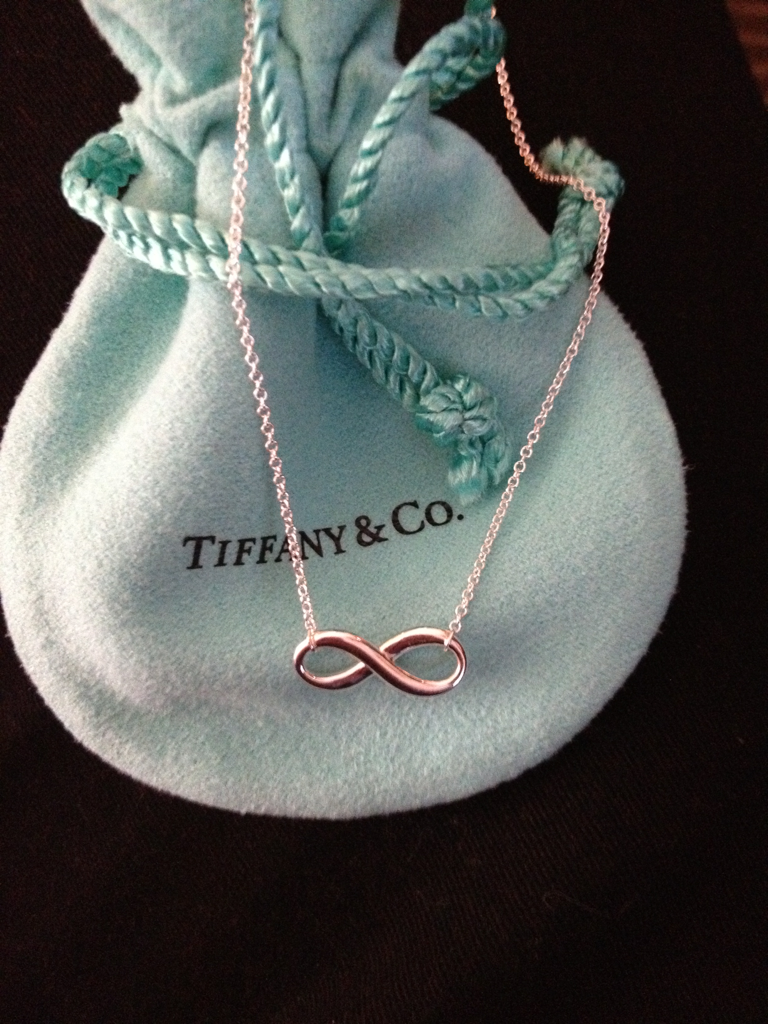 Infinity necklace. i have this little tiffany bag from another necklace i got :)