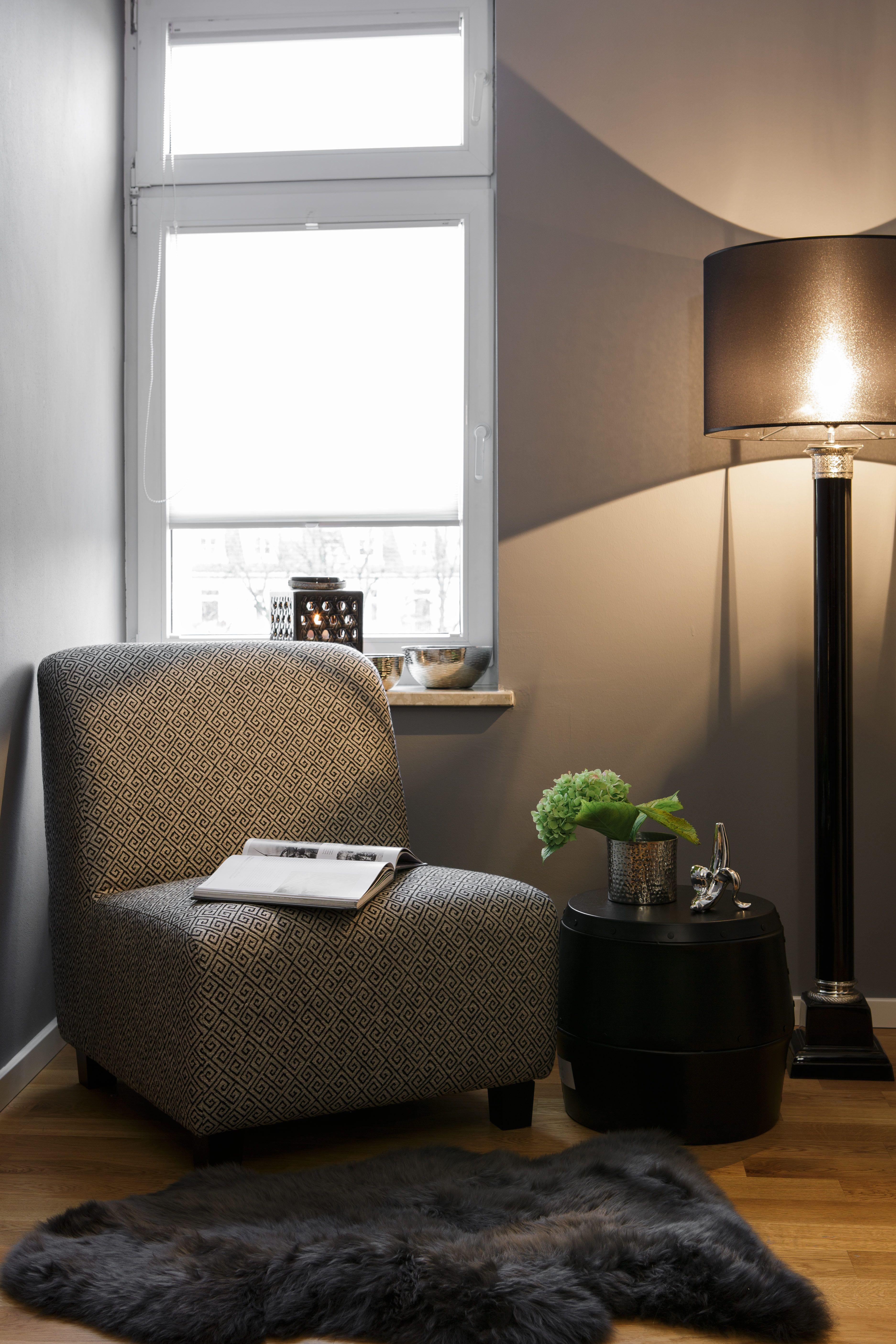 """Eine separate Sitzecke im Schlafzimmer schafft einen """"Raum in Raum ..."""