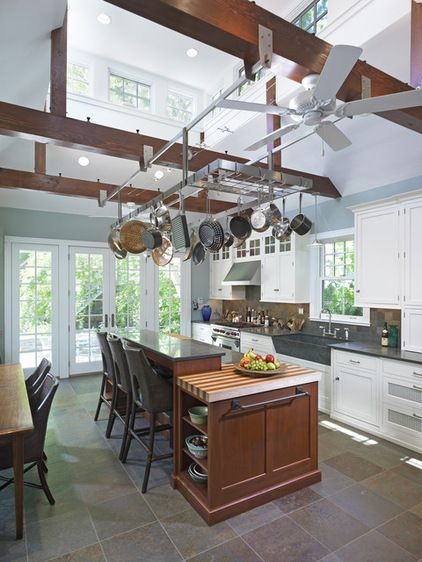 rustic kitchen by Krieger + Associates Architects Inc