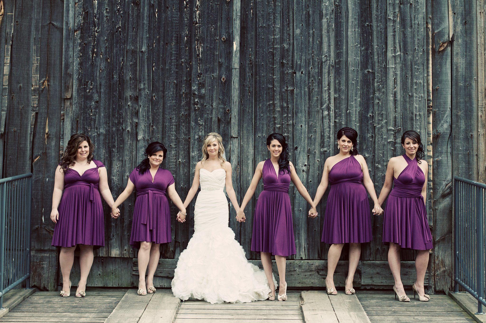 Bridesmaids wearing Henkaa\'s Sakura Convertible Dresses in Plum ...