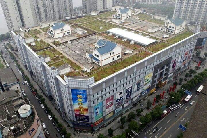 In china there are houses built on the roof of shopping malls