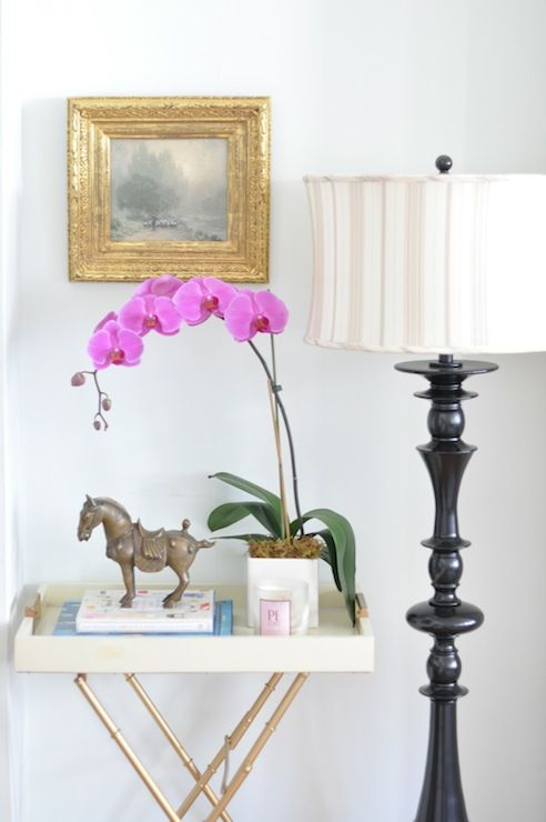 Chic Foyer With Glossy Black Floor Lamp, Square Gold Leaf Frame, Gold Faux  Bamboo Tray Table And Orchid.
