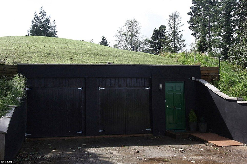 Property pioneers build devon home inside a for Building a detached garage on a slope