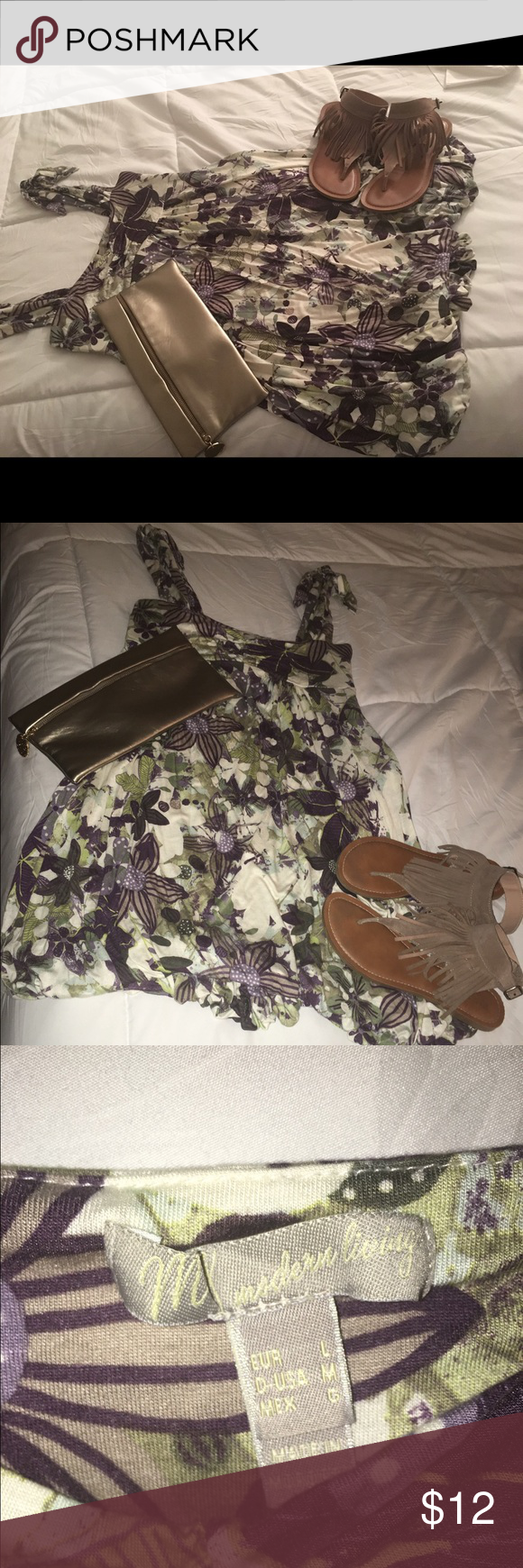 Beautiful flowery print bubble dress. Short bubble hem dress. Flower print. Adjustable tie straps. Really cute for errand runs or date night with your honey. Pair with some cute sandals or heels and denim jacket and be on your way!  MNG  Dresses Mini