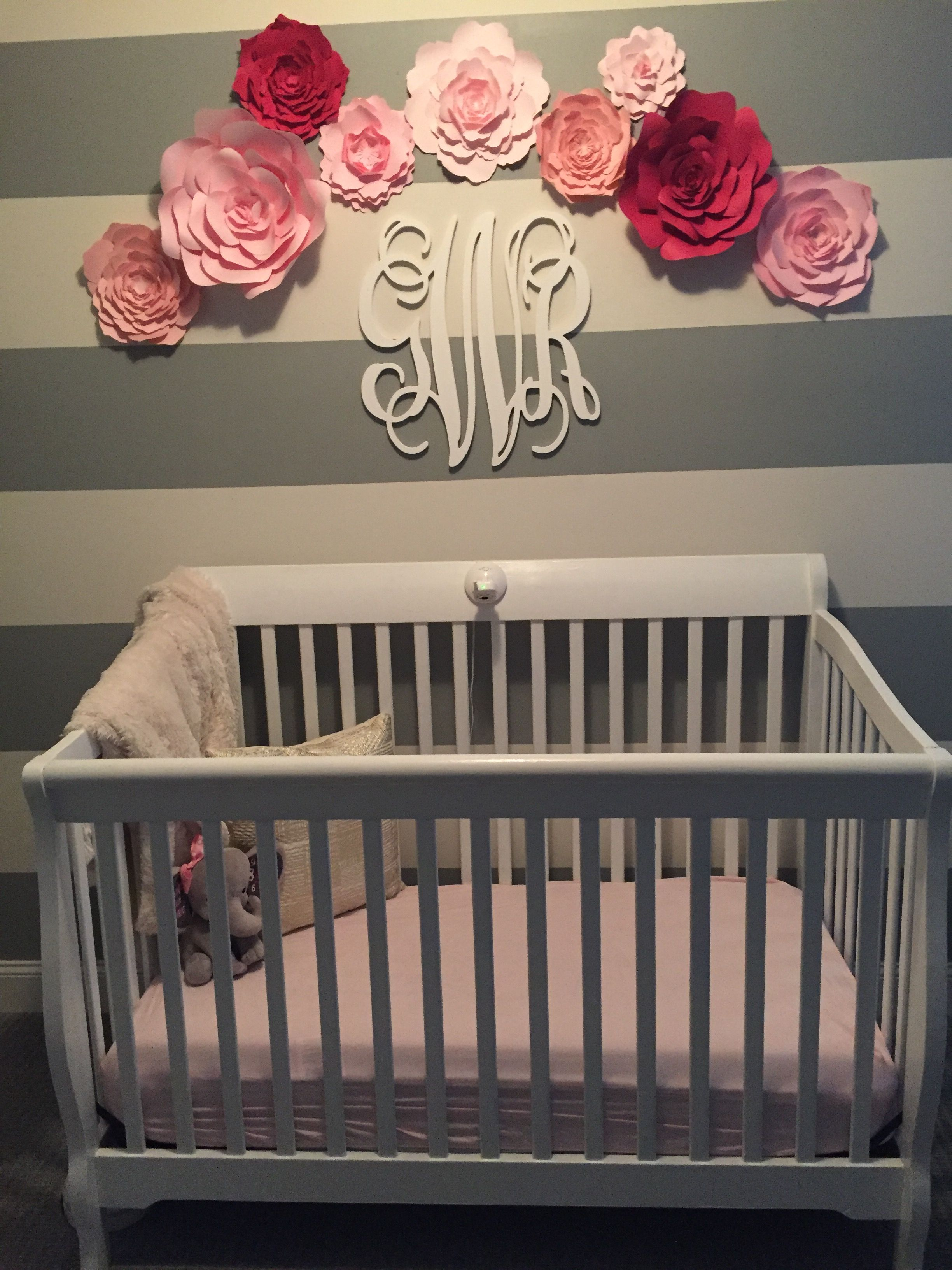 White Striped Wall In Baby Nursery