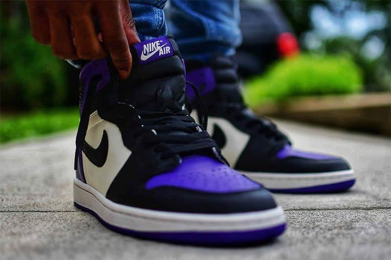 air jordan 1 low court purple on feet