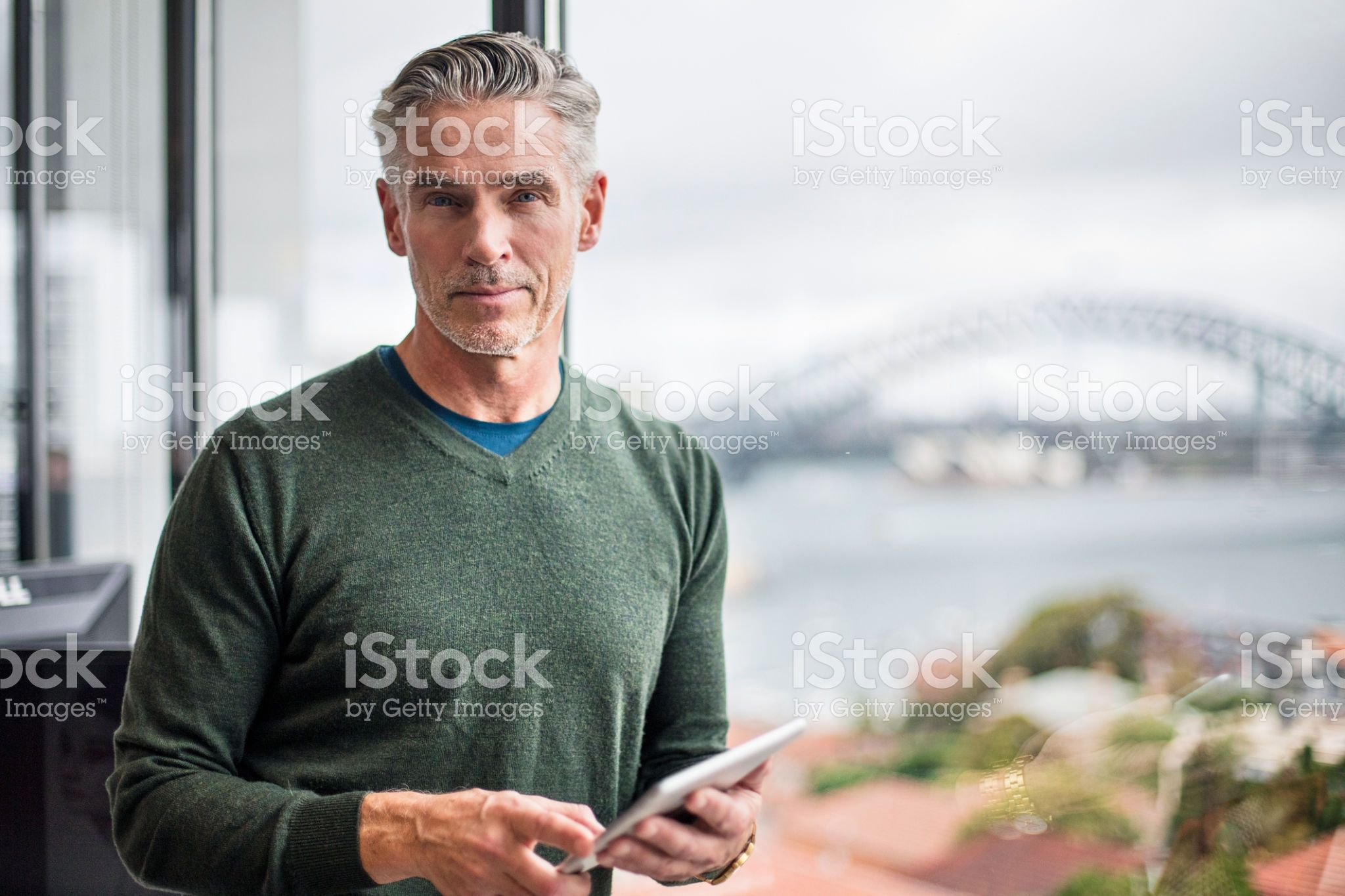 Portrait Of A Businessman With Digital Tablet In Office Stock