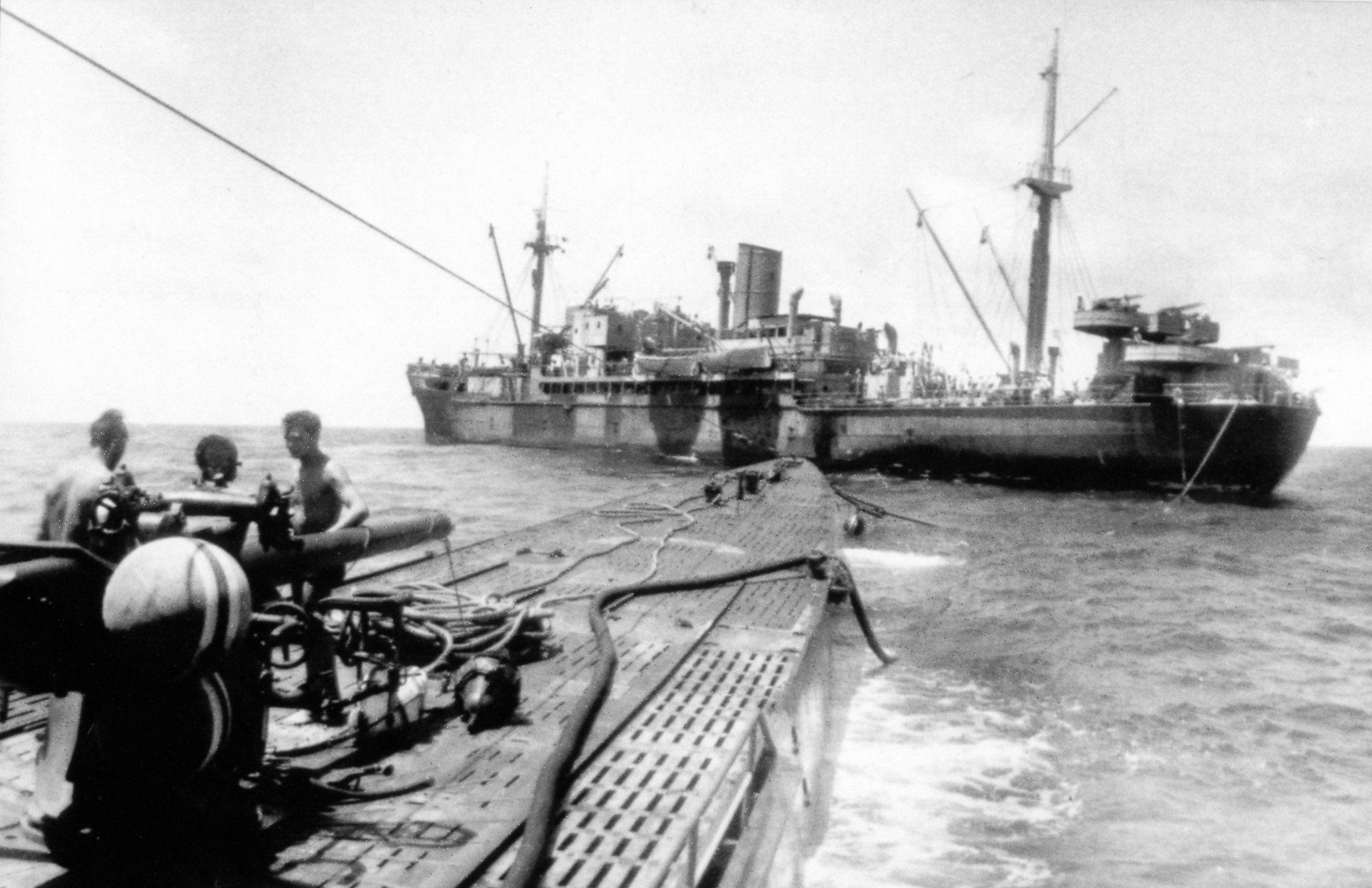 German sub U-124 refueling at sea. The supply vessel is ...