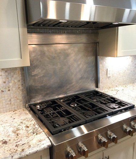 What do engineers change in their houses that other people would not think of? - a hinged cover to both protect the tile backsplash, and provide extra counter space.
