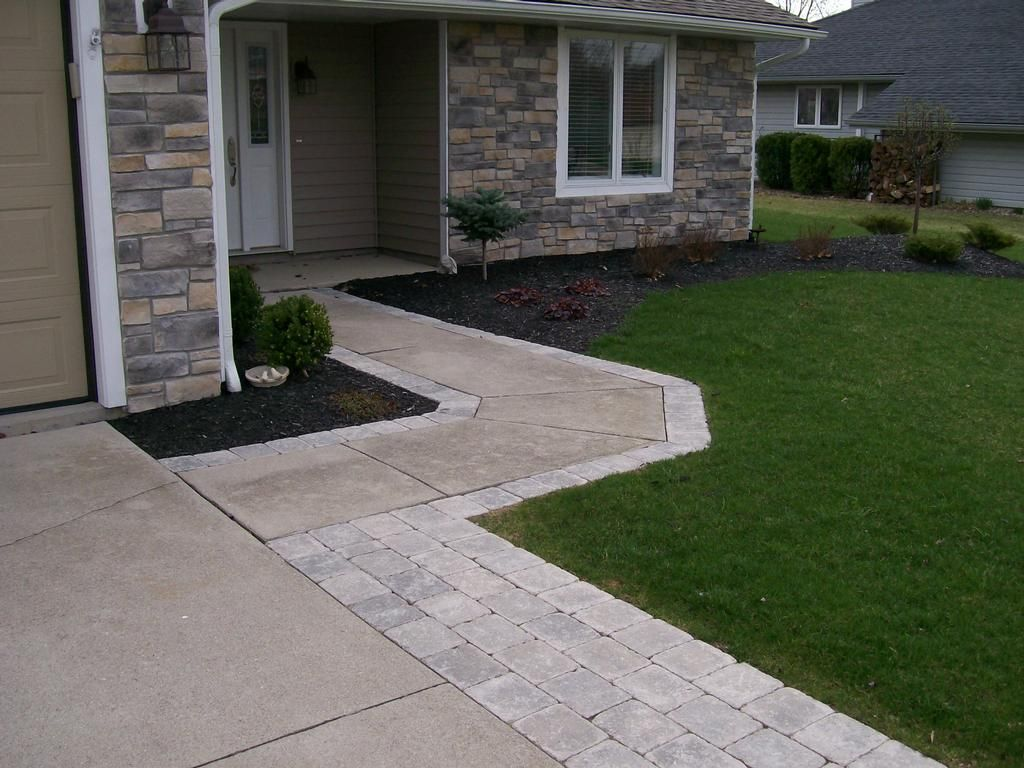 widening the driveway and walkway with paver stones instead of