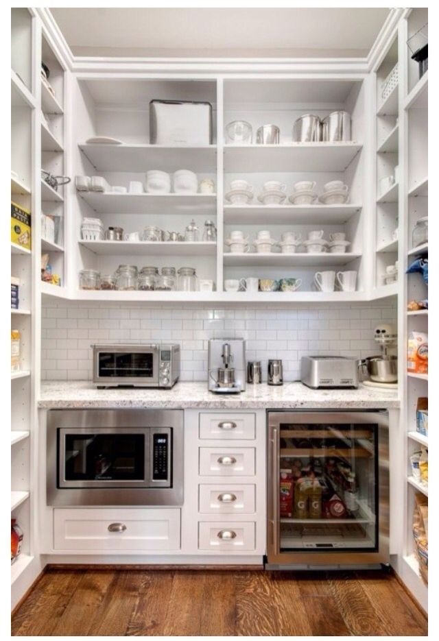 Butler pantry via zillow Microwave, bar fridge, overhead shelf ...