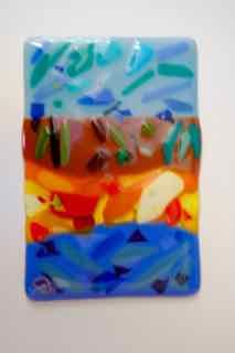 Clara C created this lovely landscape composition using a variety of opal sheet glass. Layering with a final full fuse added to the brilliance of the hues. Nice careful work!