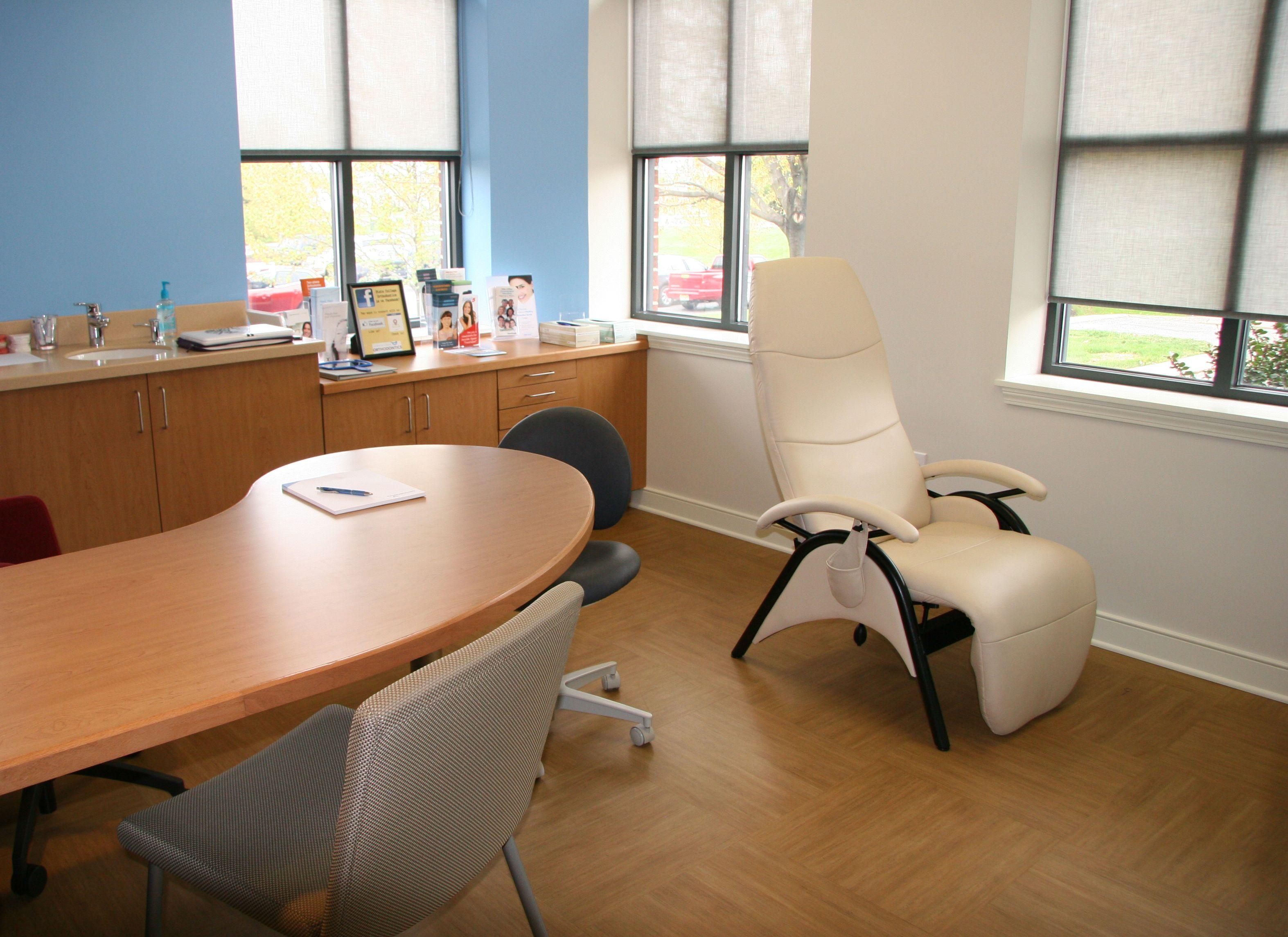 Zero gravity exam chair in orthodontic consultation room