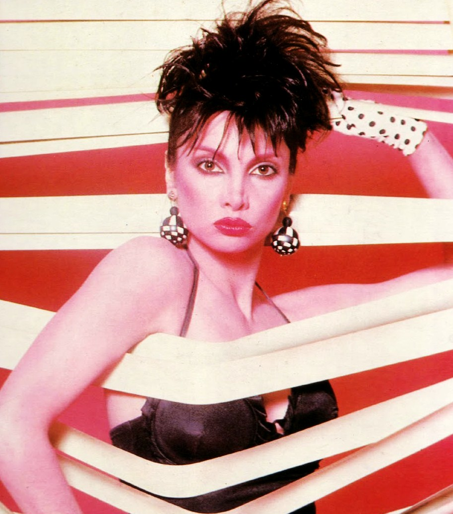 spiky hair and 80s earrings toni