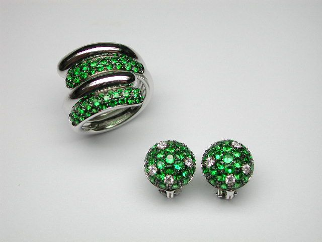 Margherita Burgener Abbraccio rings in white gold and tzavorite with matching earrings.