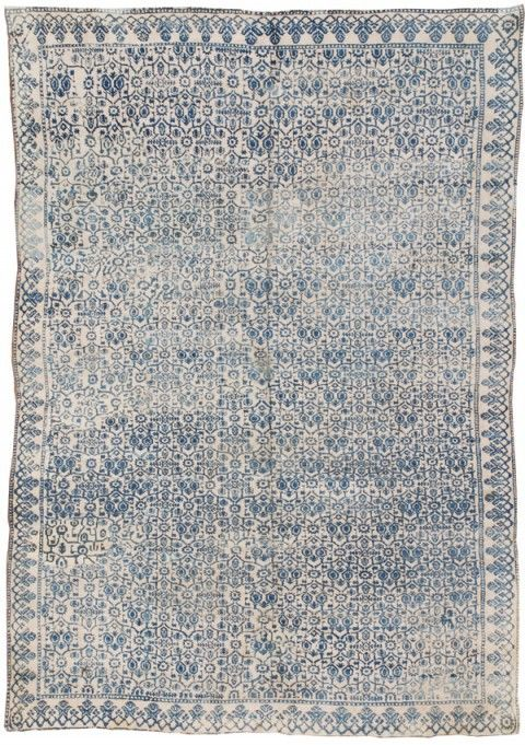 Washed silk rug with hint of blue and gray