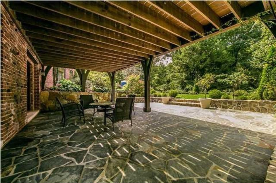 Patio below the deck - 1930's tudor style home in Tennessee