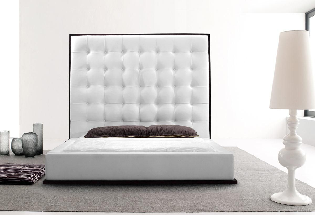 white leather bed with high headboard and wood grain trim
