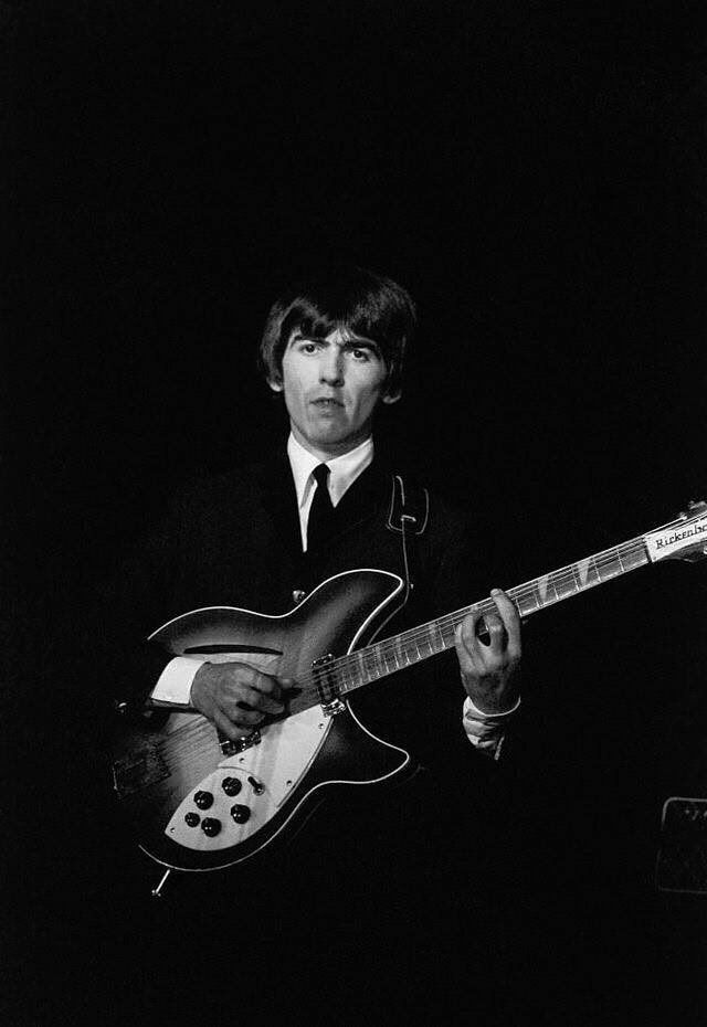 George Harrison Playing His Rickenbacker 12 String Guitar On Stage With The Beatles