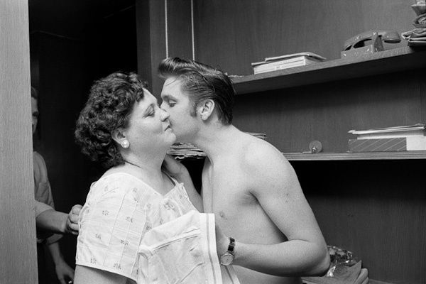 It's A Fair Exchange  After a long 27 hour train trip from New York to Memphis Elvis receives a clean pair of Jockey shorts from his mother Gladys and she gets a kiss on the cheek in exchange. 1034 Audubon Dr., Memphis, TN, July 4, 1956.